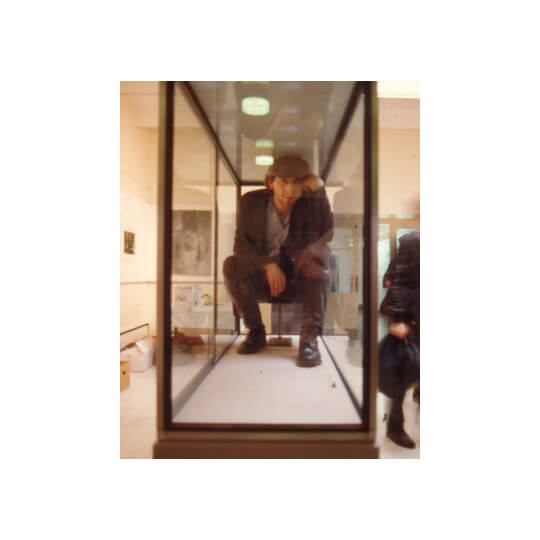 Posing inside a display cabinet as The Thinker